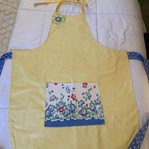 Vintage pillowcase apron in yellow.